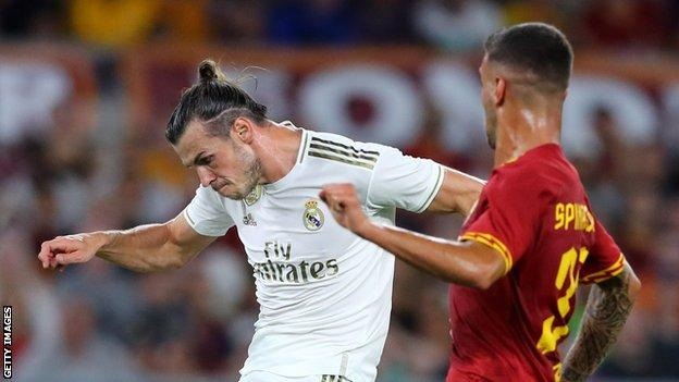Gareth Bale (left) in action against Roma