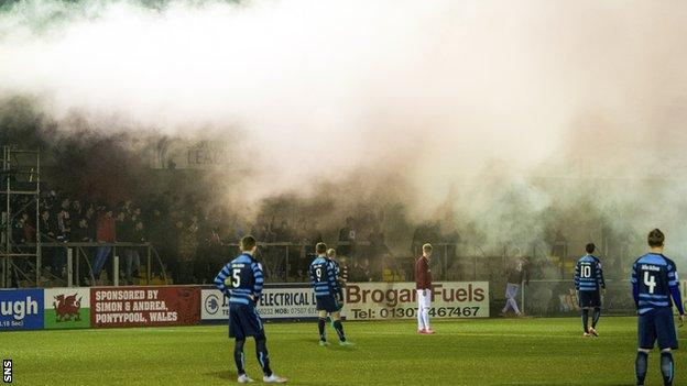 A flare goes off at Station Park, Forfar