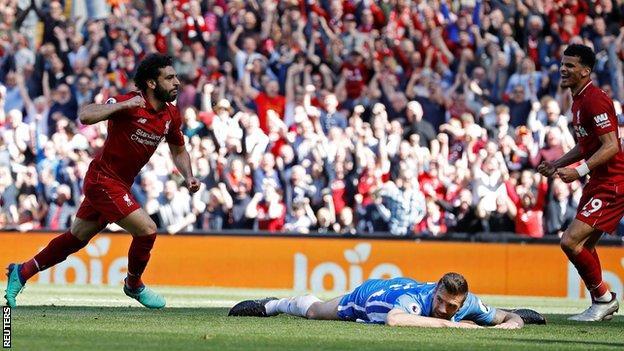 Mohamed Salah (left) celebrates scoring
