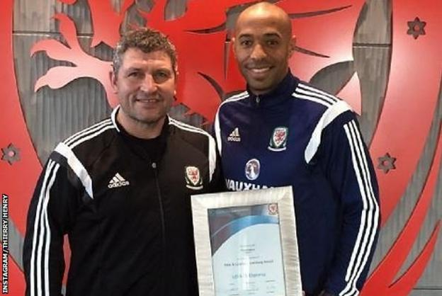 Thierry Henry poses with Wales assistant manager Osian Roberts after completing his coaching badges
