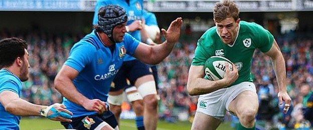Ireland wing Andrew Trimble takes on the Italy defence