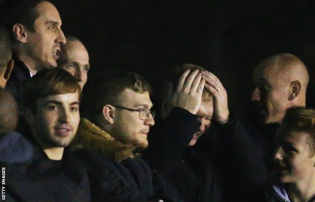 Gary Neville (left), Paul Scholes (hands on head) and Nicky Butt (right)