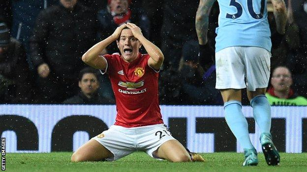 Manchester United midfielder Ander Herrera reacts to being booked for diving against Manchester City