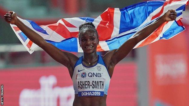 Dina Asher-Smith celebrates at the 2019 World Championships