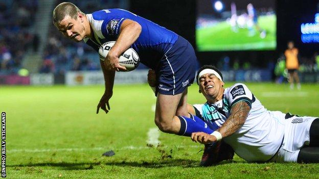 Johnny Sexton scores a try in the first half despite a tackle from Josh Matavesi