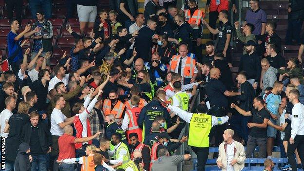 Burnley and Arsenal fans confront each other at Turf Moor