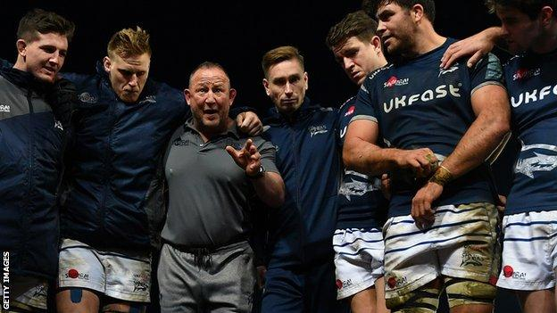 Steve Diamond in a team huddle with his Sale Sharks players