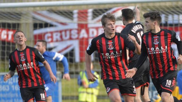 Diarmuid O'Carroll (right) celebrates scoring a late equaliser to give the champions a 1-1 draw with Ballinamallard
