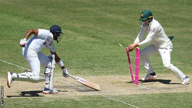 India batsman Ravichandran Ashwin (left) is run out by Australia's Marnus Labuschagne (right) during the third Test