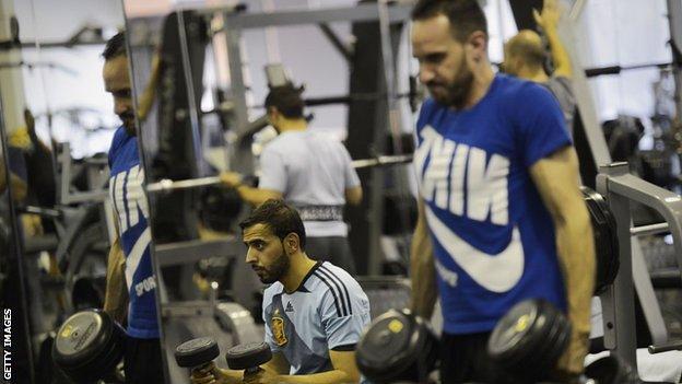 Men exercising in a gym