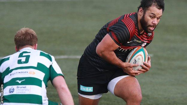 Billy Vunipola runs with the ball