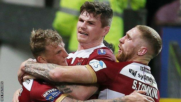 Sam Tomkins (right) celebrates with double try-scorer Dom Manfredi (left) during Wigan's 12-4 Grand Final win over Warrington Wolves