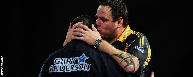 Gary Anderson is embraced by beaten finalist Adrian Lewis