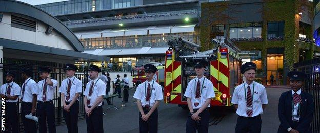 "A Wimbledon spokesman said the fire alarm ""may have been caused by an electrical fault"""