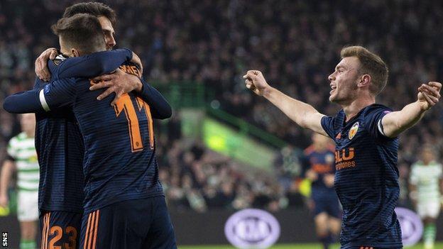Valencia's Denis Cheryshev (centre) celebrates his opener with his team mates