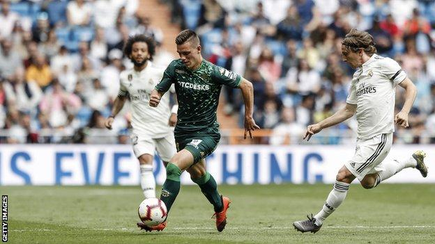 Giovani Lo Celso in action against Real Madrid