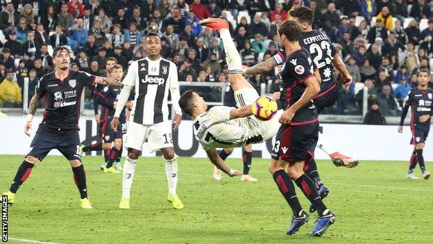 Cristiano Ronaldo attempts an overhead kick while playing for Juventus