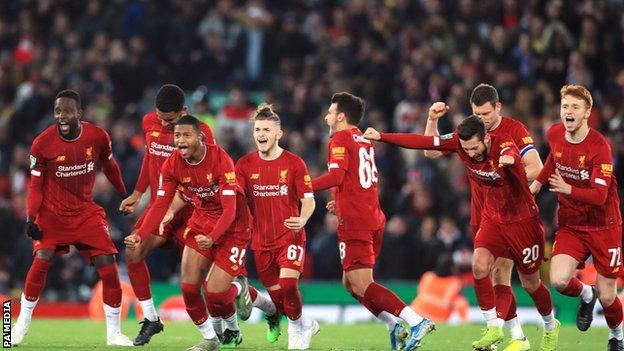 Liverpool celebrate beating Arsenal 5-4 on penalties after a 5-5 draw in the League Cup