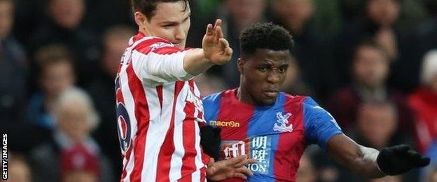 Wilfried Zaha, right, worked hard down the right to give Palace an outlet and stop Stoke from pouring forward with all of their attacking resources