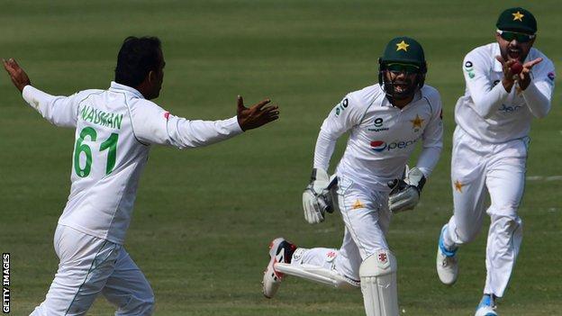 Nauman Ali celebrates taking a wicket