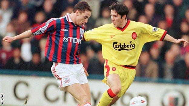 Jamie Fullarton (left) tackles Liverpool's Oyvind Leonhardsen