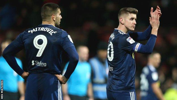 Aleksandar Mitrovic and Tom Cairney after Fulham's defeat by Brentford