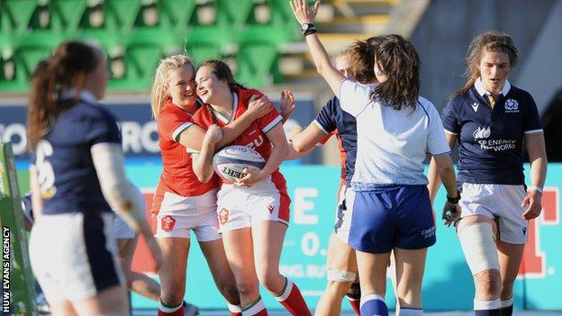 Caitlin Lewis celebrates a try