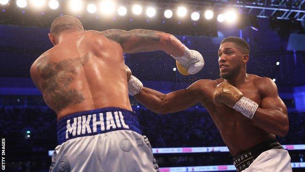 Anthony Joshua punches Oleksandr Usyk