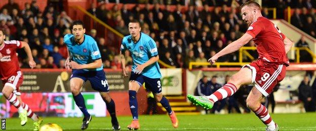 Adam Rooney scores Aberdeen's opener from the penalty spot