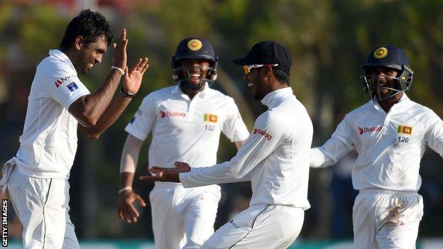 Sri Lanka's Dilruwan Perera (left) celebrates after taking a wicket against Australia