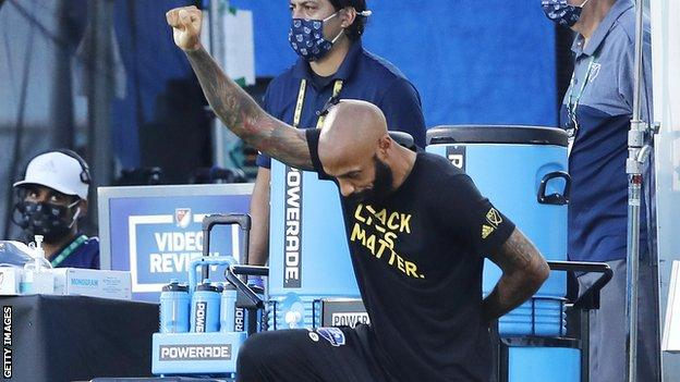Thierry Henry takes a knee in support of the Black Lives Matter movement before CF Montreal's match with Toronto FC