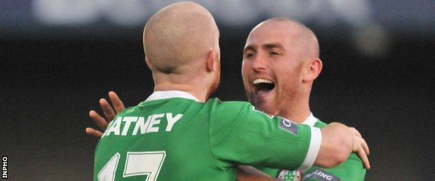 Ryan Catney and Barry Johnston celebrate a Cliftonville goal in November 2011