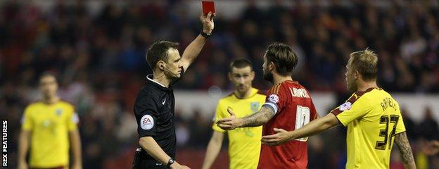 Henri Lansbury is sent off after his clash with Ben Mee