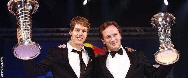 Sebastian Vettel and Christian Horner of Red Bull in 2010 collecting the Drivers and Constructors Championship trophies