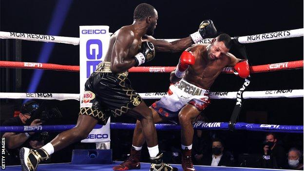 Kell Brook (right) is hit by a punch from Terence Crawford (left) while against the ropes