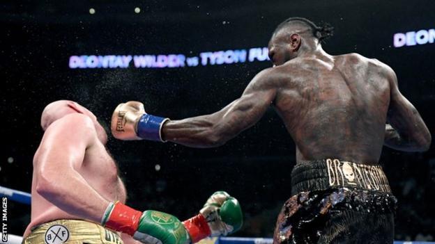 Deontay Wilder knocking down Tyson Fury
