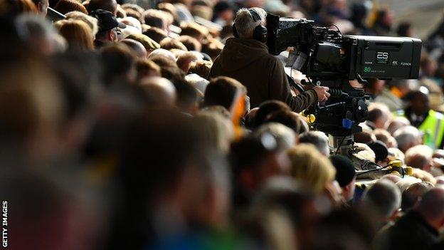 TV camera among the crowd