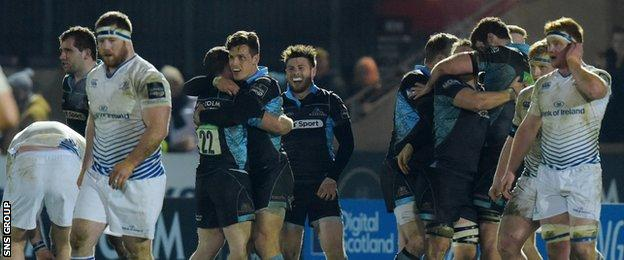 Glasgow celebrate a victory that keeps them in touch with the top four