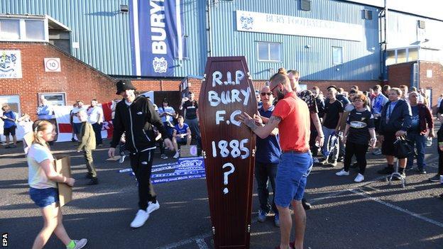 Bury fans outside Gigg Lane