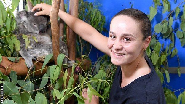Ashleigh Barty with a koala bear