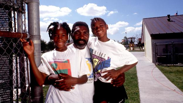Richard Williams, centre, with his daughters Venus, left, and Serena in 1991