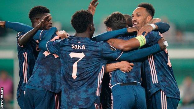 Arsenal celebrate scoring against Rapid Vienna