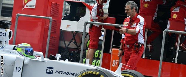 Arrivabene gives a thumbs-up to Massa in the pits shortly afterwards
