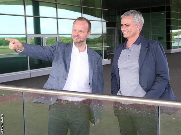 A smiling Jose Mourinho (right) is pictured at Manchester United's training ground with executive vice-chairman Ed Woodward on Sunday