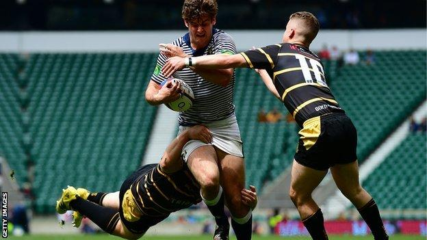 Billy Searle was at Twickenham to stop tries as well as score them, aided in halting Cheshire's Jack Lavin by Tom Cowan-Dickie