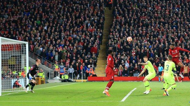 Wijnaldum heads in Liverpool's third goal at Anfield to square the tie at 3-3