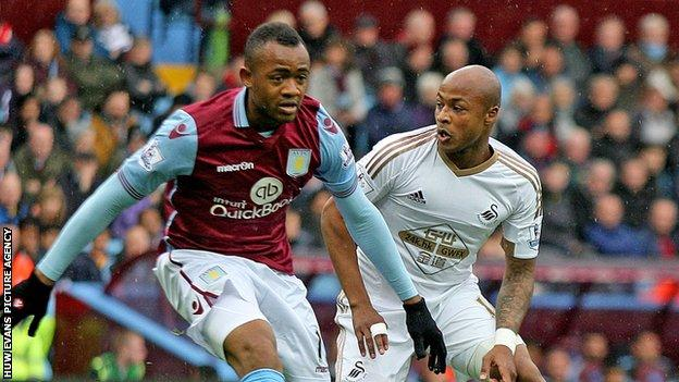 Brothers Jordan and Andre Ayew playing against each other in 2015