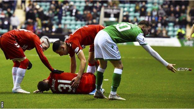 A bottle was aimed at Borna Barisic after he was fouled by Ryan Porteous