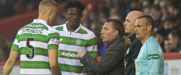 Celtic managers Brendan Rodgers (second right) with defenders Jozo Simunovic and Dedryck Boyata