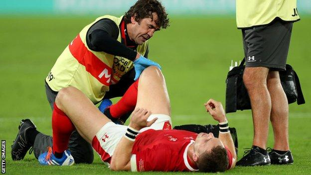 George North receives treatment